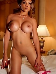 Exotic babe with perfect tits takes it all off on her bed