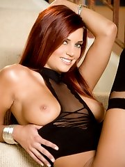 Jayden Cole spreads her long legs and gives her boobs the squeezing it needs